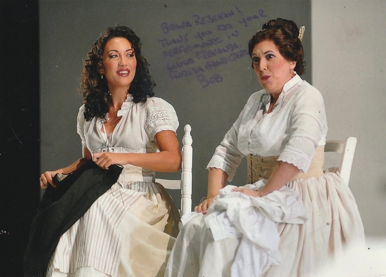 Rebekah Diaz Fandrei on stage with mezzo-soprano Raquel Pierotti in 'Luisa Fernanda' at Florida Grand Opera. Maestro Plácido Domingo conducting.