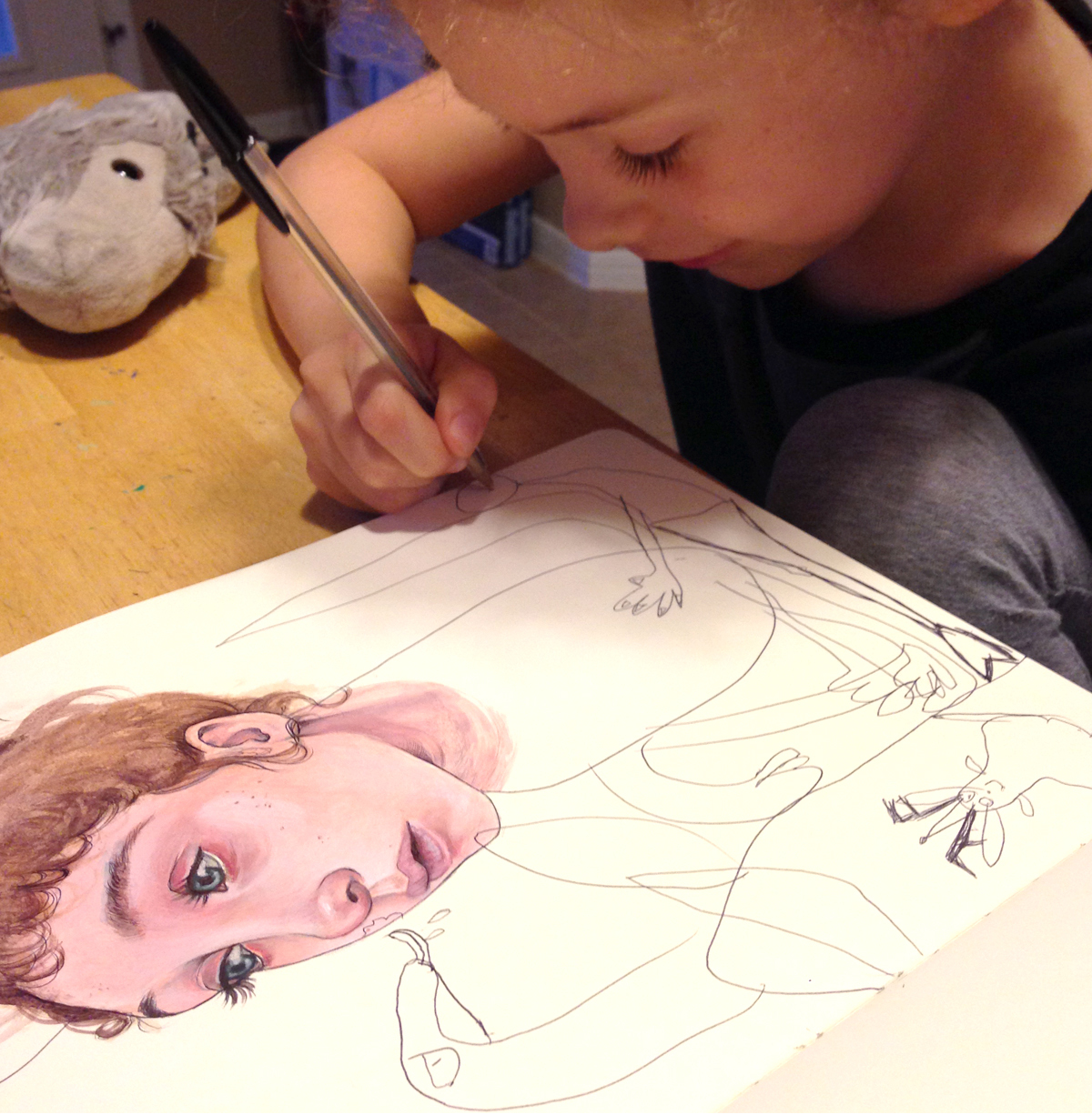 Mica's daugher, Myla Hendricks, adding finishing touches to Mica's illustration.