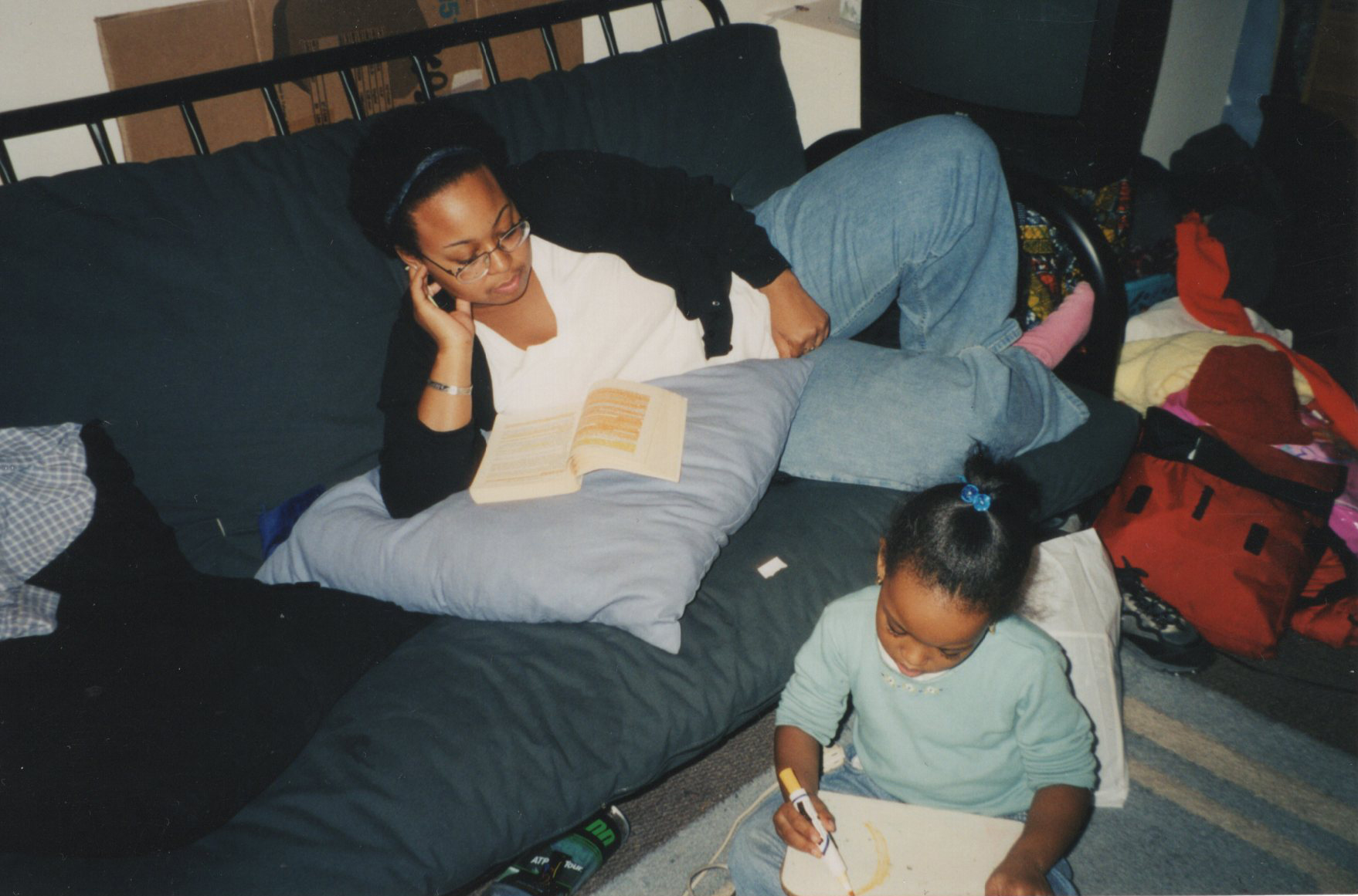 Christa studying with her daughter, Nikierra.