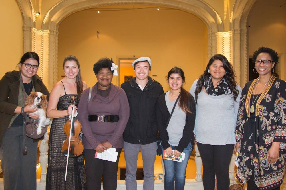Kate Hatmaker pictured with at-risk youth from Art of Élan's collaboration with A Reason to Survive (ARTS) in National City, California.