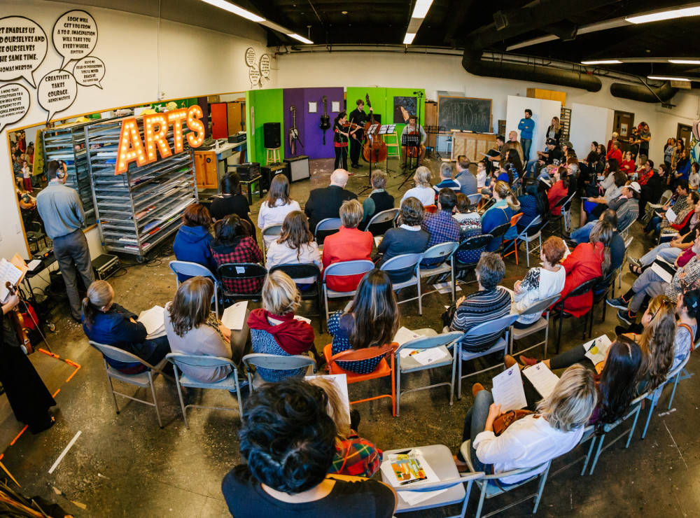 Audience taking in an Art of Élan performance at A Reason to Survive (ARTS) in National City, California.