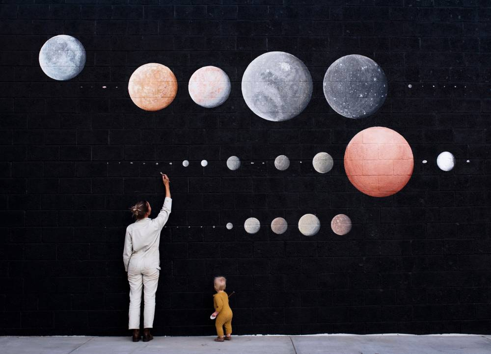 Stella and Wyeth, making last touches on '48 Moons', a mural in downtown Denver