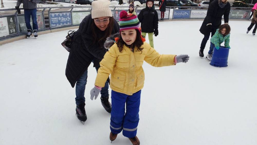 Sitora, skating with her daughter, Munisa in Milwaukee, Wisconsin.