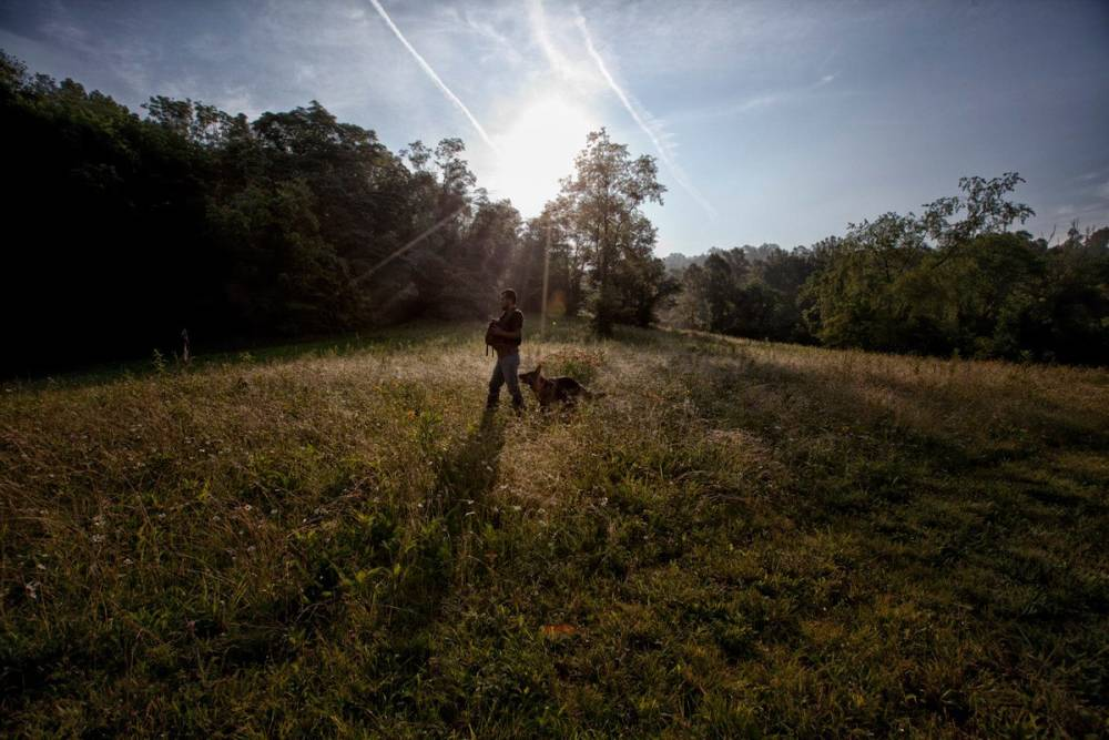 Sarah Menkedick's husband Jorge Santiago, with their daughter Elena and dog, at the setting of Sarah's book 'Homing Instincts', rural Ohio.