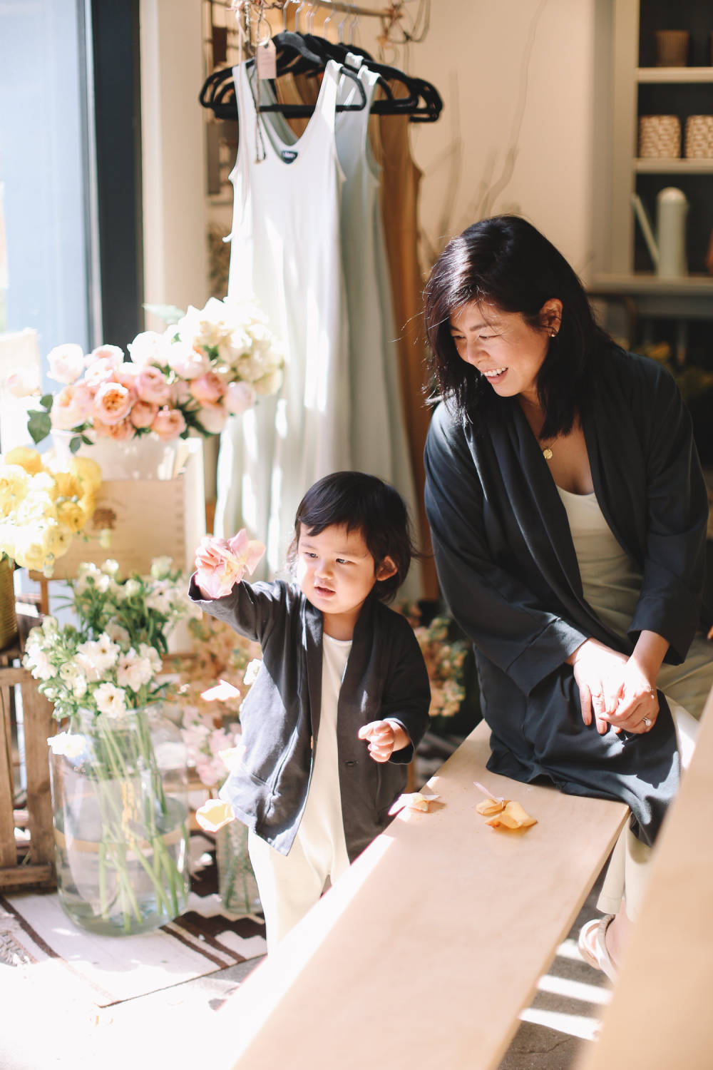 Lisa Hsieh with her son Greysen, wearing pieces from her collection. Photo: Jenna Norman