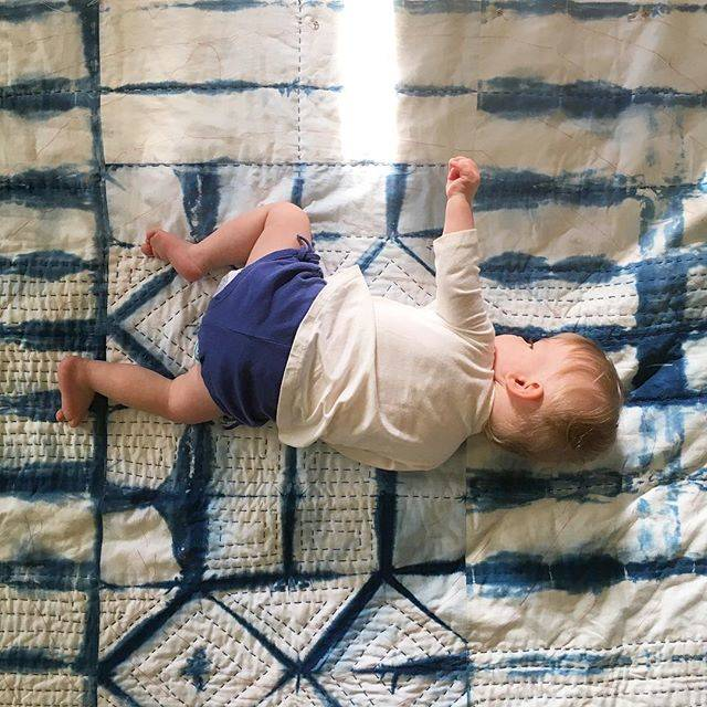 Baby Etta with her quilt, a work in progress.