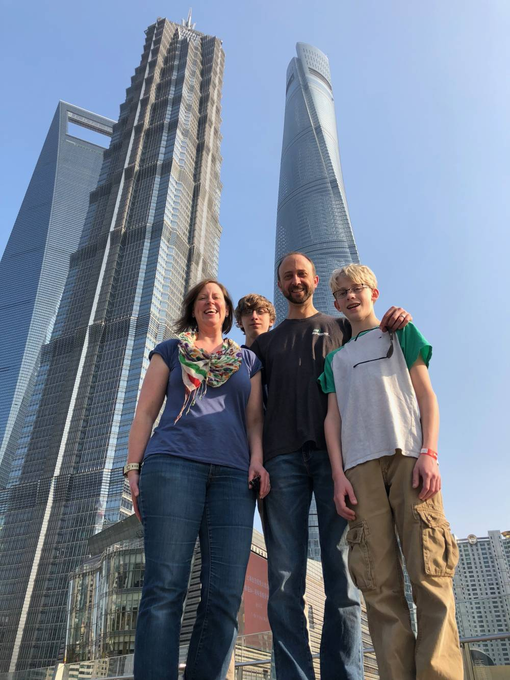 Megan Woodard Johnson with her husband Mike and two sons Evan and Zach, on a family trip to China.