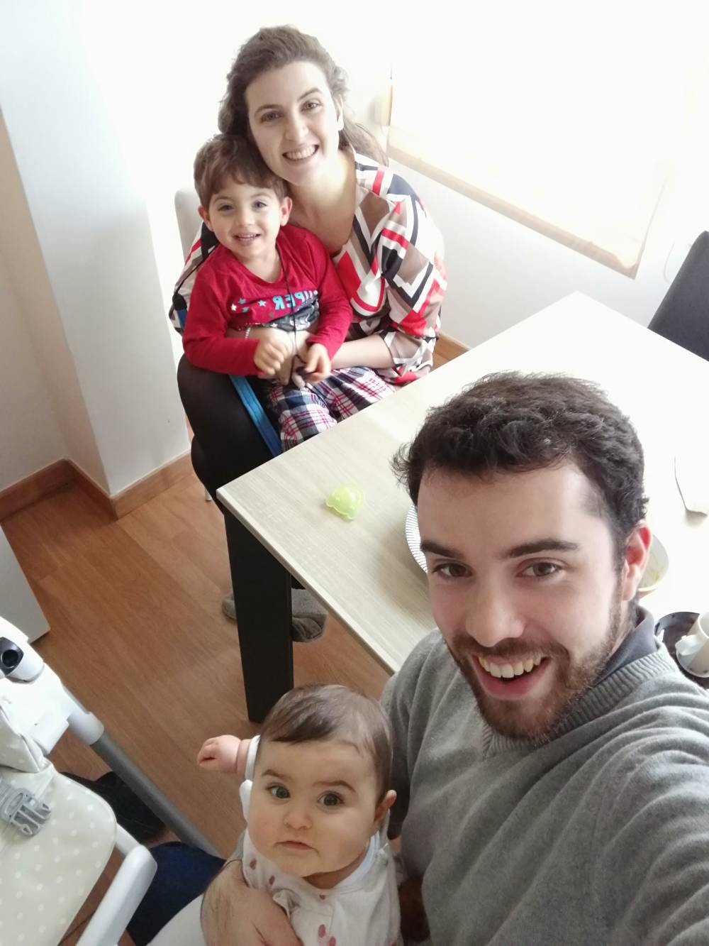 Sara Infante, with her husband João and children Estêvão and Esperança on Christmas morning.